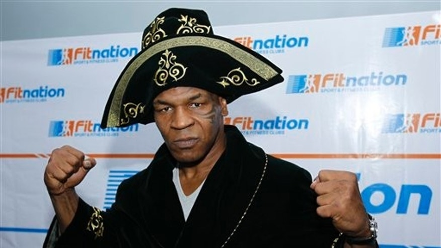 Mike Tyson poses in a traditional Kazakh outfit at the 1st Astana International Action Film Festival in Astana, Kazakhstan, Wednesday, June 30, 2010. Tyson presented  his movie Tyson  at the festival on Tuesday. (AP Photo/Nikita Bassov)