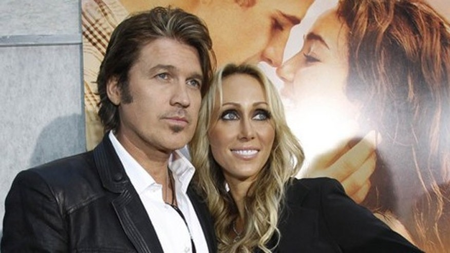 "March 25: Tish Cyrus (R) and her formerly estranged husband, musician Billy Ray Cyrus, pose at the premiere of ""The Last Song."""