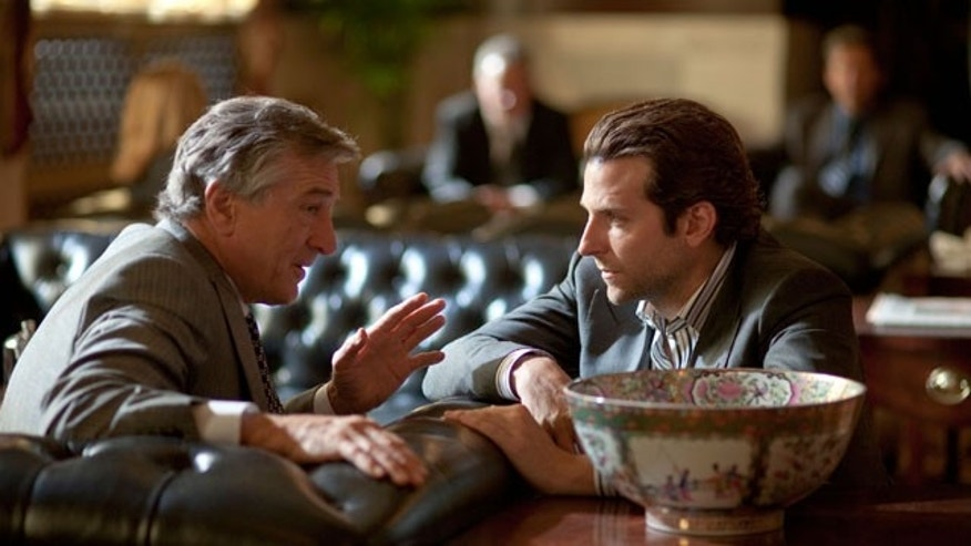 "In this film publicity image released by Relativity Media, Robert De Niro, left, and Bradley Cooper are shown in a scene from ""Limitless."""