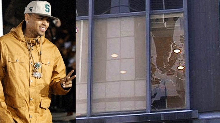 Chris Brown at an event in February, 2011, and a cracked window above the GMA studios on March 22, 2011. (Reuters/FOXNews.com)
