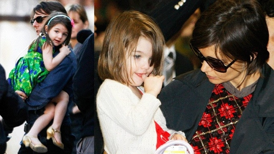 Suri with dad Tom Cruise and mom Katie Holmes. (Reuters)