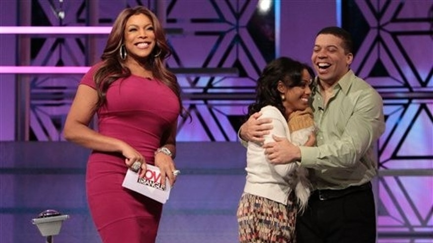 "In this Jan. 28, 2011 photo released by the Game Show Network (GSN), TV personality Wendy Williams, left, appears with unidentified contestants during the taping of the game show, ""Love Triangle,"" in Los Angeles. (AP)"