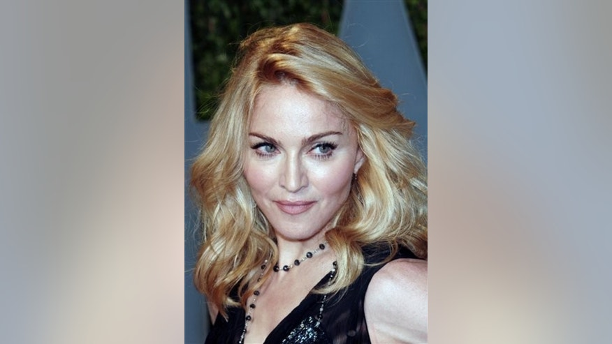 FILE - In this Feb. 22, 2009 file photo, Madonna arrives at the Vanity Fair Oscar party , in West Hollywood, Calif. The father of a girl from Malawi whom Madonna hopes to adopt says he's capable of taking care of his daughter. Madonna's appeal of a court ruling denying her request to adopt the girl is to be heard Monday, May 4, 2009, in Malawi.  (AP Photo/Evan Agostini, file)