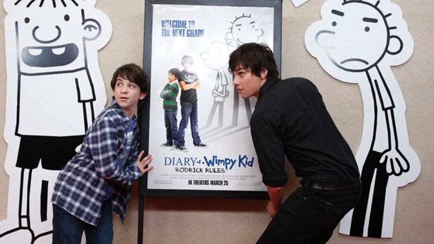 March 24, 2011: Diary of a Wimpy Kid: Rodrick Rules actors, Zachary Gordon, left, and Devon Bostick pose on the red carpet during the movie premiere on at the Tapestry Charter High School in Buffalo, N.Y.