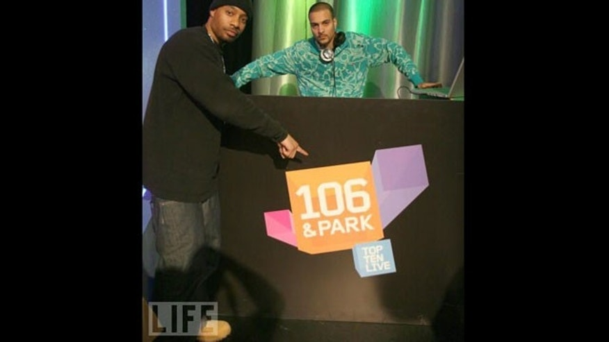 "DJ Megatron (left) on the set of BET's ""106 & Park"" in 2007. (LIFE)"