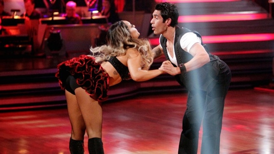 "March 28, 2011: In this publicity image released by ABC, radio personality ""Psycho"" Mike Catherwood, right, and his partner Lacey Schwimmer perform on the celebrity dance competition series, ""Dancing with the Stars"" in Los Angeles."
