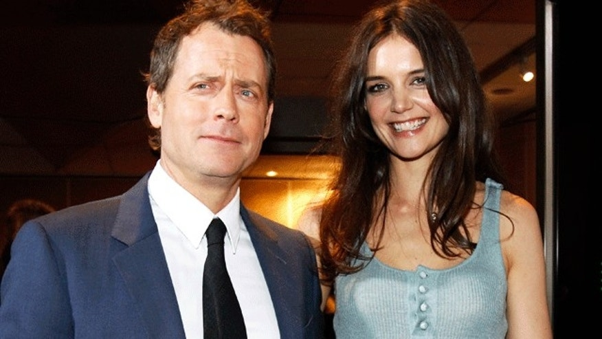 Greg Kinnear and Katie Holmes. (Reuters)