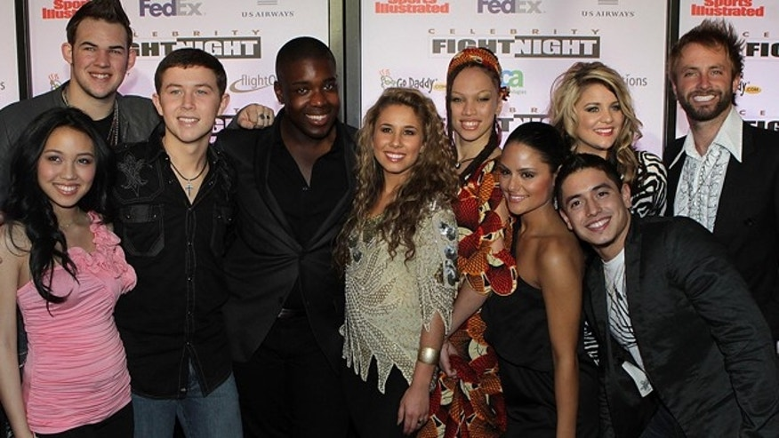 American Idol's Top Ten singers (left to right) Thia Megia, James Durbin, Scotty McCreery, Jacob Lusk, Haley Beinhart, Naima Adedapo, Pia Toscano, Stefano Langone, Lauren Alaina and Paul McDonald arrive at Muhammad Ali Celebrity Fight Night XVII on Saturday March. 19, 2011, in Phoenix.