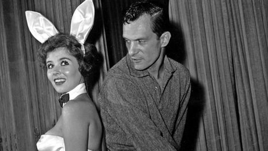 Hugh Hefner and a Playboy bunny in the 1960s. (AP)