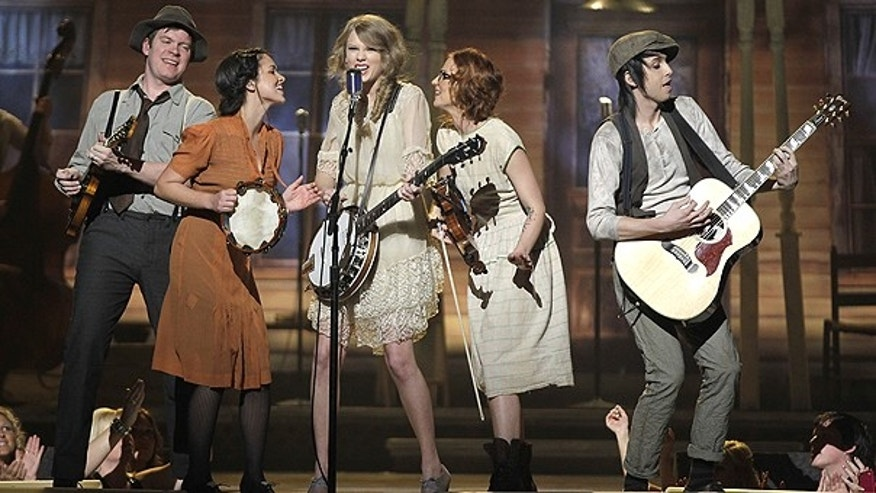 April 3: Taylor Swift, center, performs at the 46th Annual Academy of Country Music Awards in Las Vegas.