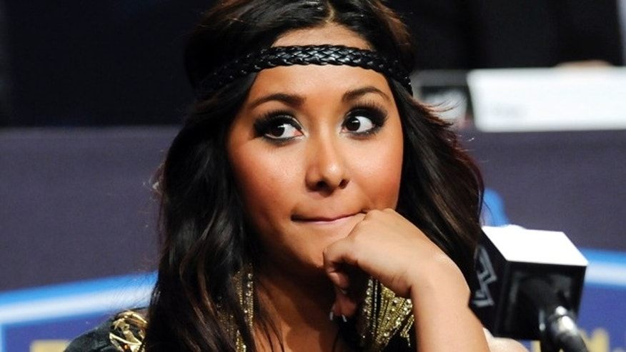 "March 30, 2011: Reality television star Nicole ""Snooki"" Polizzi participates in a Wrestlemania XXVII press conference at the Hard Rock Cafe."