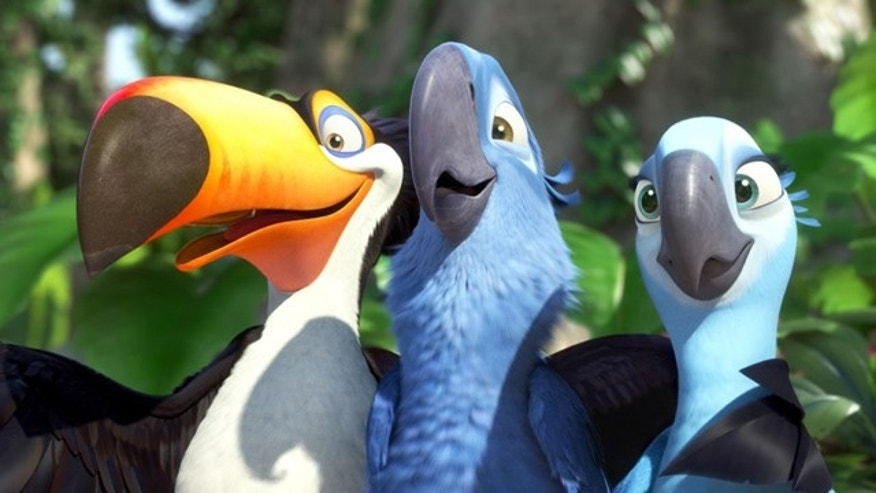 "In this publicity image released by 20th Century Fox, animated characters, from left, Raphael, voiced by George Lopez, Blu, voiced by Jesse Eisenberg, and Jewel, voiced by Anne Hathaway, are shown in a scene from ""Rio."""