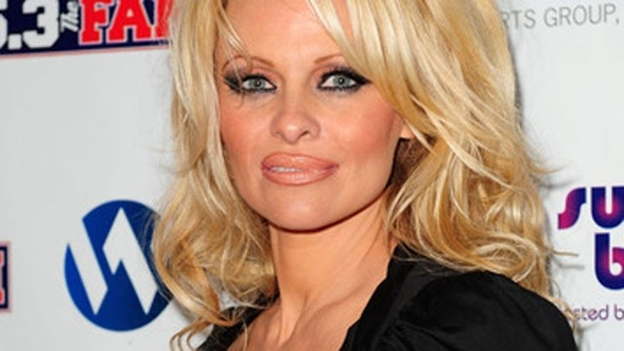 Feb. 6: Pamela Anderson usually has a full face of makeup on, like this. Check her out without makeup below. (Gustavo Caballero/Getty Images)