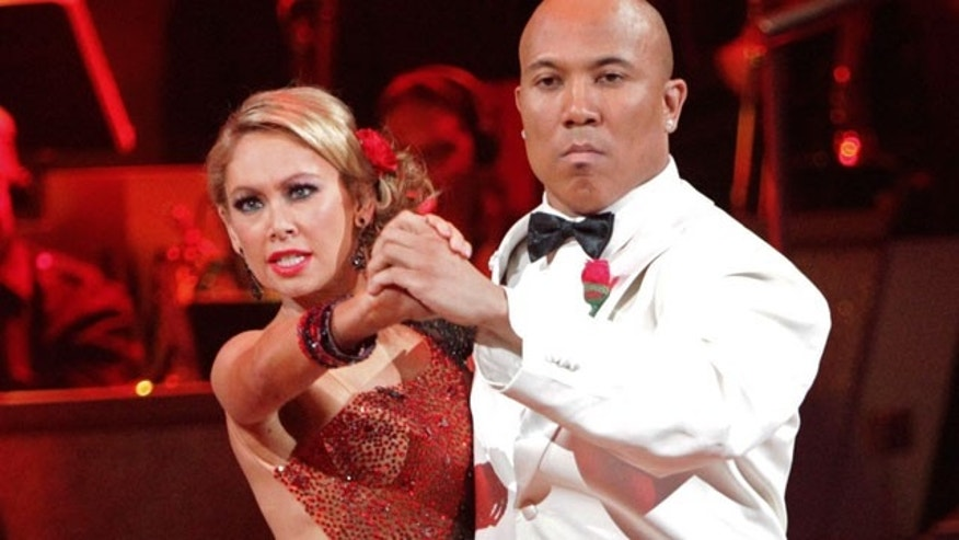 "This May 2, 2011 file photo provided by ABC shows Hines Ward, right, and his partner Kym Johnson performing on the celebrity dance competition series ""Dancing with the Stars"" in Los Angeles. (AP)"
