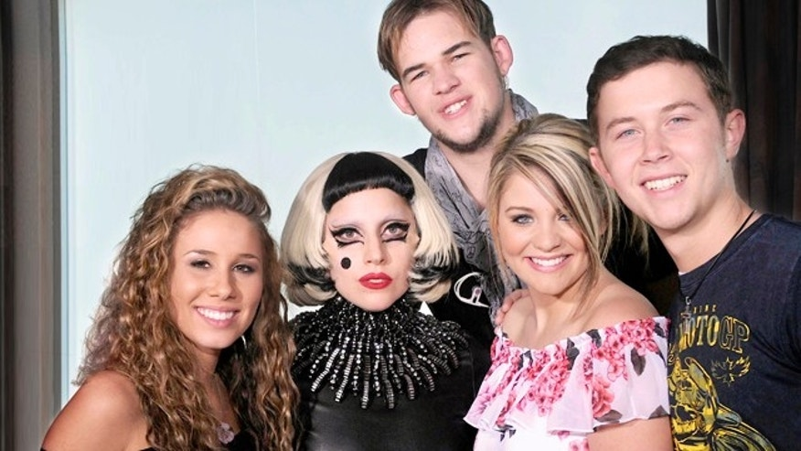 "May 11: In this publicity image released by Fox, Lady Gaga, center, poses with the final four contestants, from left, Haley Reinhart, James Durbin, Lauren Alaina and Scotty McCreery from the singing competition series ""American Idol"" in Los Angeles."