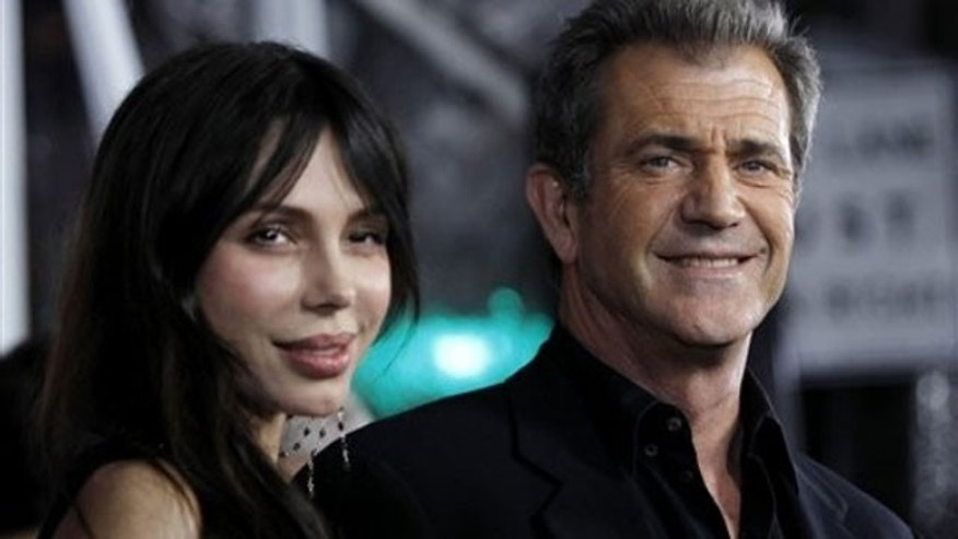 Mel Gibson with ex-girlfriend Oksana Grigorieva, whose sister allegedly leaked tapes of Mel's rants.