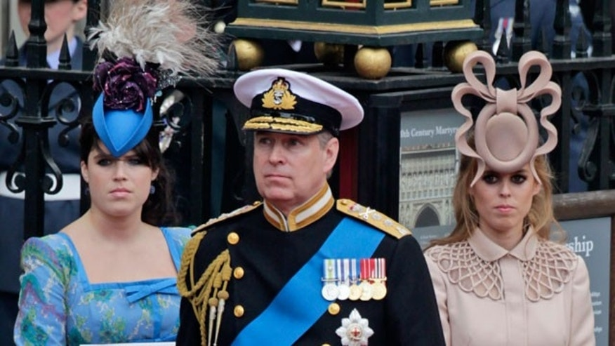 In this Friday, April, 29, 2011 file picture Britain's Prince Andrew, center, and his daughters Britain's Princess Eugenie, left, and Britain's Princess Beatrice leave Westminster Abbey at the Royal Wedding in London. (AP)