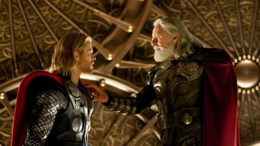 "In this film publicity image released by Paramount Pictures, Chris Hemsworth, left, and Anthony Hopkins are shown in a scene from the film, ""Thor"". (AP/Paramount Pictures-Marvel Studios)"