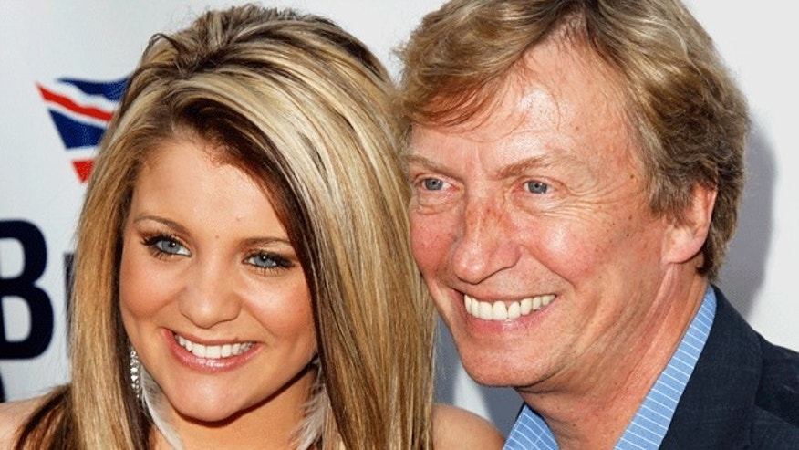 Nigel Lythgoe and 'Idol' hopeful Lauren Alaina. (Reuters)