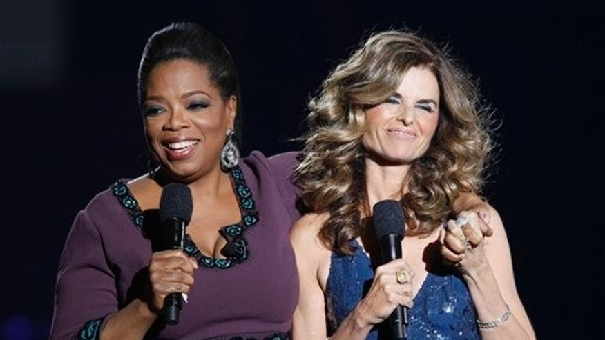 May 17: Oprah Winfrey and Maria Shriver at Oprah's final taping. (AP)