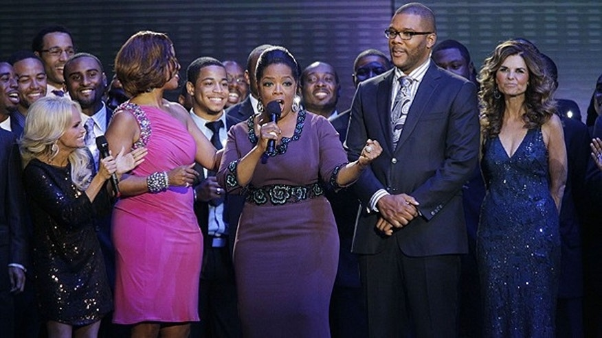 May 17: Oprah Winfrey talks as she is surrounded by Kristin Chenoweth, left, Gayle King, Tyler Perry and Maria Shriver, right, during a star-studded double-taping of 'Surprise Oprah! A Farewell Spectacular' in Chicago.
