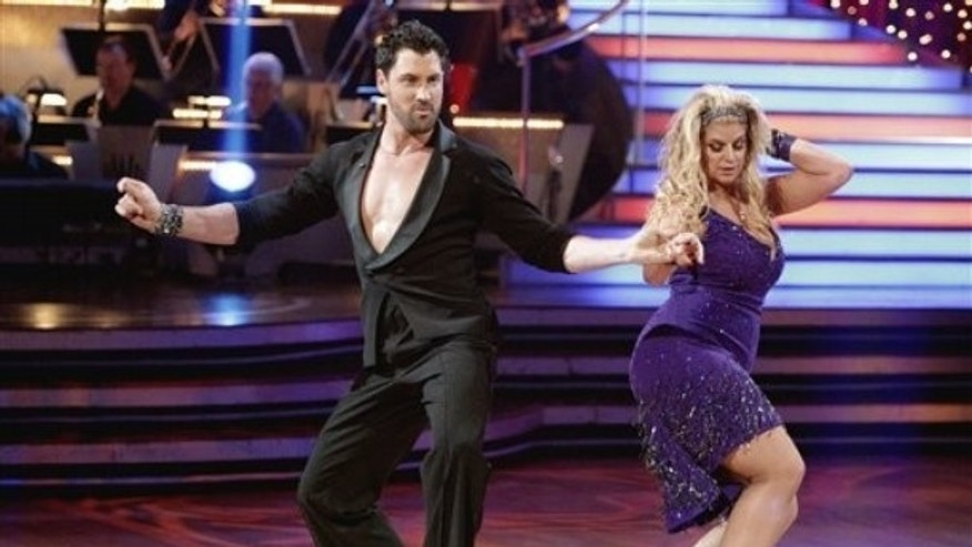 "In this publicity image released by ABC, Kirstie Alley, right, and her partner Maksim Chmerkovskiy compete during the celebrity dance competition ""Dancing with the Stars."" (AP)"