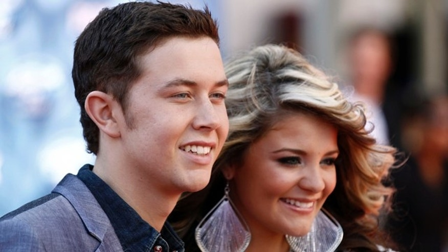 May 25: Finalists Scotty McCreery, left, and Lauren Alaina arrive at the American Idol Finale in Los Angeles.