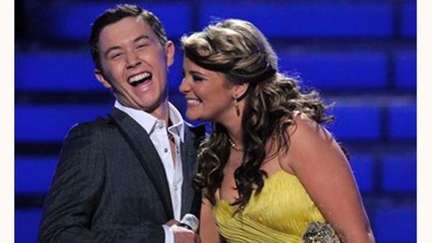 "Finalists Scotty McCreery, left, and Lauren Alaina are seen onstage before the winner is announced at the ""American Idol"" finale on Wednesday, May 25, 2011, in Los Angeles. (AP Photo/Chris Pizzello)"