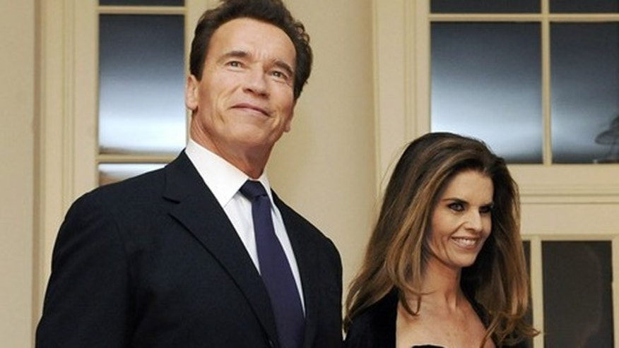 California Governor Arnold Schwarzenegger arrives with his wife Maria Shriver for a dinner held for the National Governors Association by US President Barack Obama at the White House in Washington in this February 22, 2009 file photo. The former California first lady has moved out after 25 years of marriage, and the couple confirmed their separation in a joint statement released on May 9, 2011, after questions raised by Los Angeles Times.   REUTERS/Jonathan Ernst/Files   (UNITED STATES - Tags: POLITICS ENTERTAINMENT)