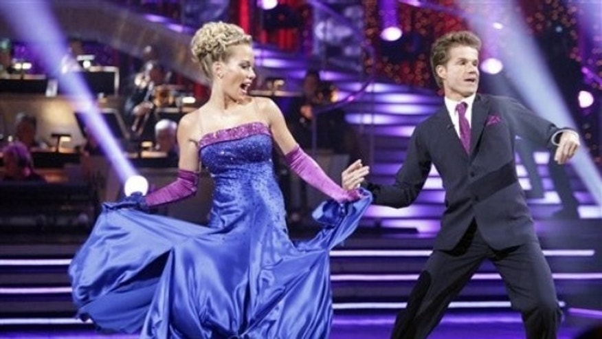 In this publicity image released by ABC, TV personality Kendra Wilkinson, left, and her partner Louis Van Amstel. (AP)