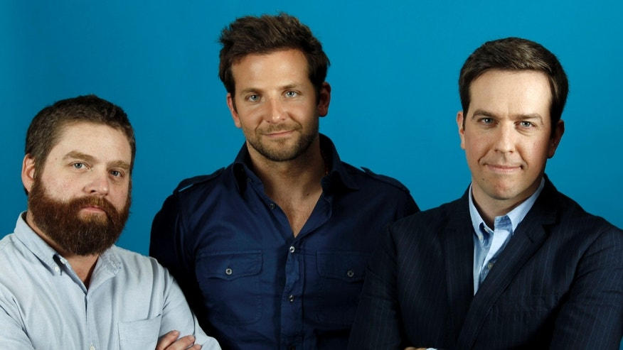 "Actors Zach Galifianakis, left, Bradley Cooper, center, and Ed Helms, stars of the upcoming film ""The Hangover Part II,"" pose for a portrait in Beverly Hills, Calif., Wednesday, May 18, 2011."