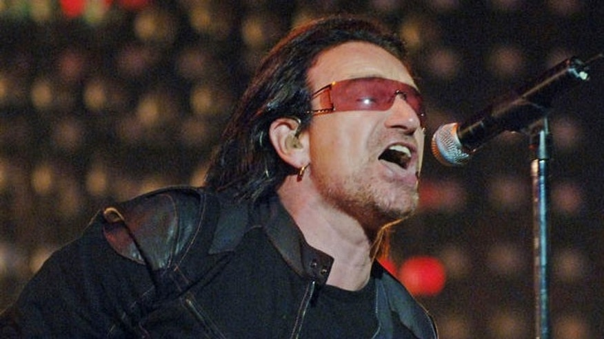 Bono from U2 performing.