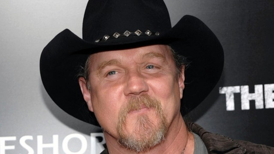 "FILE - In this March 10, 2011 file photo, musician Trace Adkins arrives at the premiere of the feature film ""The Lincoln Lawyer"" in Los Angeles. Country music star Trace Adkins has lost his home to a fire."