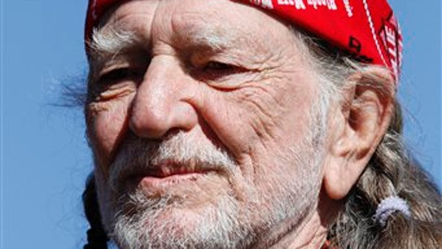 In this Nov. 7, 2010 photo, Willie Nelson performs before the start of the NASCAR AAA Texas 500 auto race at Texas Motor Speedway, in Fort Worth, Texas.