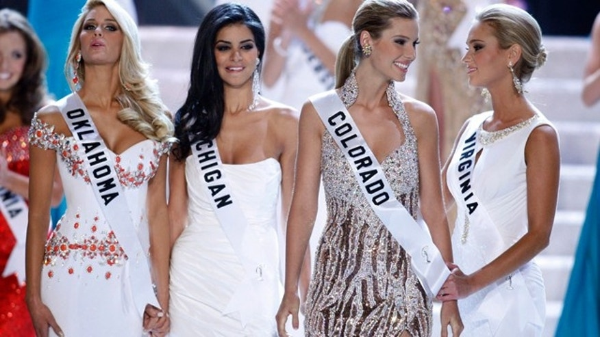 Miss Oklahoma, Miss Michigan, Miss Colorado and Miss Virginia await the results of the 2010 Miss USA pageant. (AP)