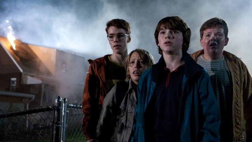 """In this film publicity image released by Paramount Pictures, from left, Gabriel Basso, Ryan Lee, Joel Courtney and Riley Griffiths are shown in a scene from """"Super 8"""" J.J. Abrams' latest sci-fi thriller opens nationwide Friday, June 10, 2011."""