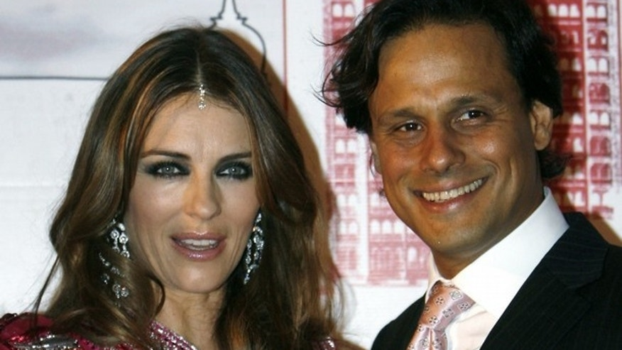 British actress Elizabeth Hurley (L) poses with husband Arun Nayar during an event for Breast Cancer Awareness in Mumbai in this October 23, 2008 file photo. (Reuters)