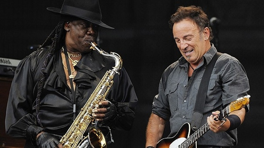 "In this July 2, 2009 file photo, U.S. rock singer Bruce Springsteen, right, and saxophonist Clarence Clemons perform during the first German concert of his ""Working On A Dream"" European tour in the Olympic stadium in Munich, Germany."