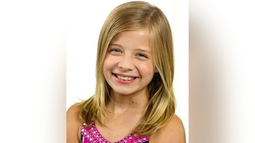 "In this June 13, 2011 photo, Jackie Evancho, a runner-up on the talent competition series ""America's Got Talent,"" poses for a portrait in New York. Though the classically inspired singer was the runner-up on ""America's Got Talent"" last year, she's been winning in every way since. Her Christmas EP, ""O Holy Night,"" went platinum after its release last fall, and her first official album, ""Dream With Me,"" debuted at No. 2. She's had her own PBS special, Oprah Winfrey requested her presence on one of her final good-bye shows, and while both Susan Boyle and Barbra Streisand appear on her new CD, Jackie more than holds her own against the two powerhouse divas. (AP Photo/Charles Sykes)"