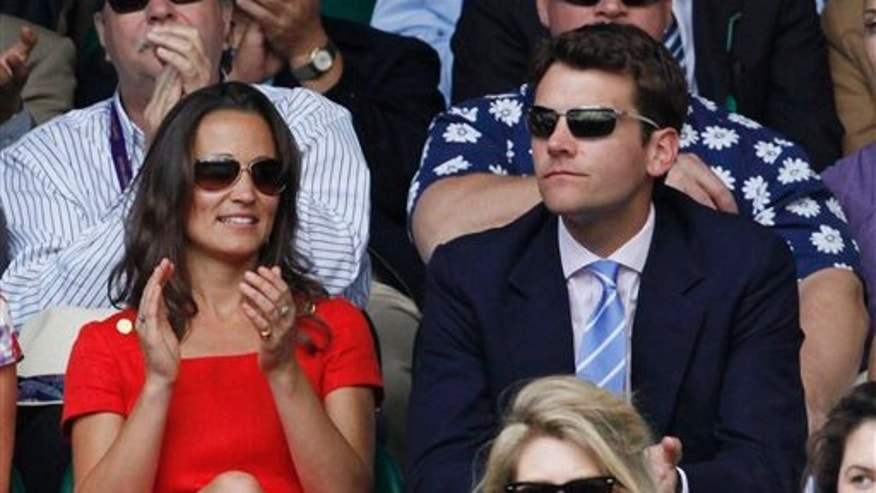 Pippa Middleton, sister of the Duchess of Cambridge, watches play on centre court with Alex Loudon at the All England Lawn Tennis Championships at Wimbledon, Wednesday, June 29, 2011. (AP Photo/Alastair Grant)