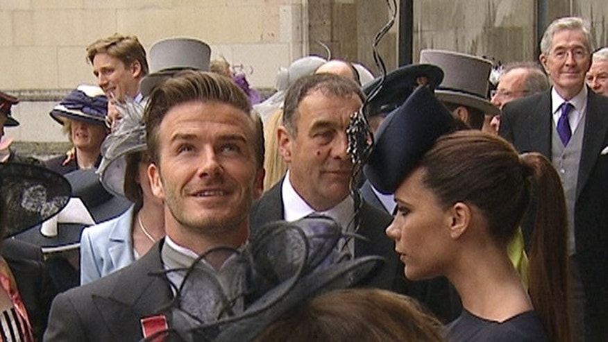 April, 29: In this image taken from video, England's soccer star David Beckham, left and his wife Victoria arrive at Westminster Abbey for the Royal Wedding in London.