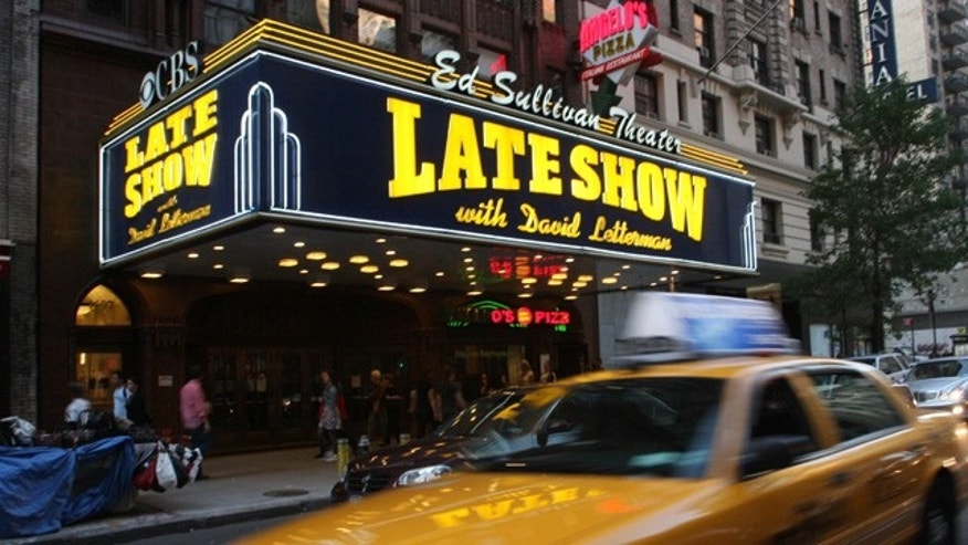 "In this Oct. 4, 2009 file photo, traffic moves down Broadway, past the Ed Sullivan Theater where the ""Late Show with David Letterman"" is taped, in New York."