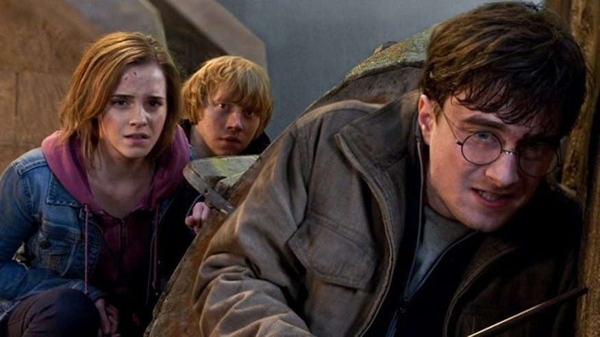 """In this film publicity image released by Warner Bros. Pictures, from left, Emma Watson, Rupert Grint and Daniel Radcliffe are shown in a scene from """"Harry Potter and the Deathly Hallows: Part 2."""""""