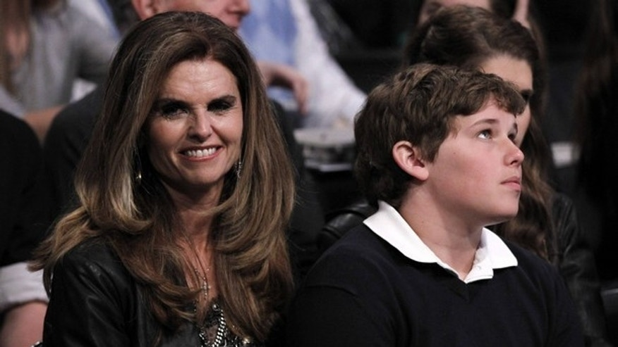 Feb. 19: Maria Shriver (L) and son Christopher Schwarzenegger (R) attend the NBA basketball All-Star weekend in Los Angeles. (AP)