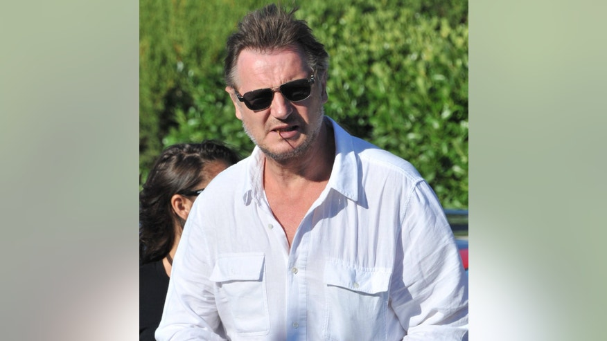 USA and AUSTRALIA ONLY Liam Neeson with his girlfriend Freya St Johnston leaving the Club 55 in Saint-Tropez, France on July 20, 2011.  July 21, 2011. X17online.com