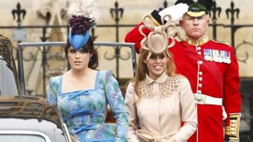 "Princess Beatrice arrives at the Royal wedding in what the press labeled the ""pretzel"" hat."