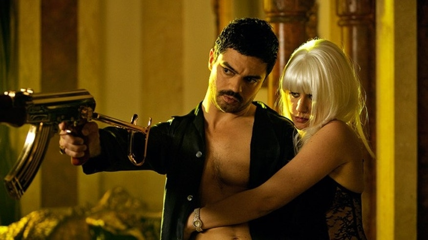 "Dominic Cooper stars with Ludivine Sagnier in ""The Devil's Double."" (Photo credit: Sofie Van Mieghem)"