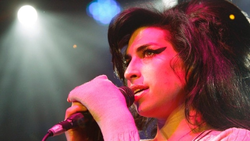 FILE - In this Oct. 25, 2007 file photo, British singer Amy Winehouse performs during her concert at the Volkshaus in Zurich, Switzerland. Winehouse was found dead Saturday, July 23, 2011, by ambulance crews who were called to her home in north London's Camden area. She was 27. (AP Photo/Keystone, Steffen Schmidt, File)