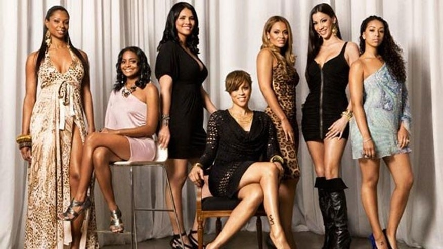 Shaunie O'Neal, center, surrounded by her 'Basketball Wives' co-stars (AP/VH1)