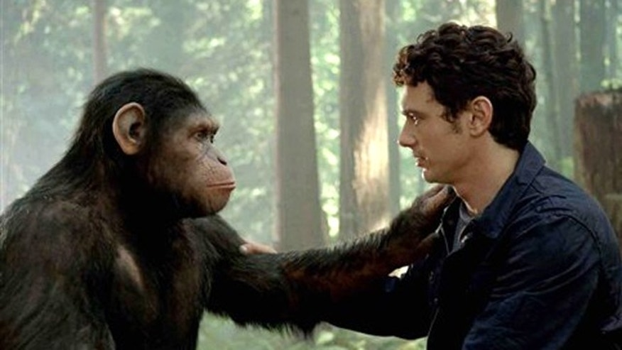 In this image released by Twentieth Century Fox, Caesar the chimp, a CG animal portrayed by Andy Serkis, and James Franco are shown in a scene from 'Rise of the Planet of the Apes.'